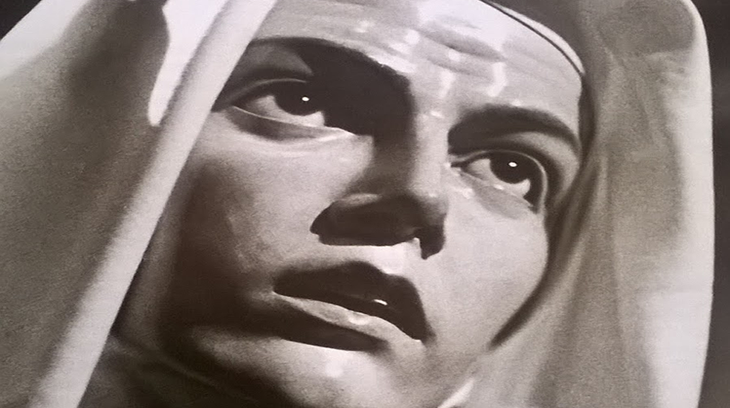 """Este rostro está grabado en el alma de muchísimos pamploneses. Este el más antiguo de los Pasos procesionales de Pamplona. Pertenece a su Ayuntamiento. Su autor en 1883 fue Rosendo Nobas y Ballbé. Es una imagen """"de vestir"""" de manera que sólo tiene talladas las manos y la cara. Es llevado a hombros por 24 portadores. Se encuentra actualmente en la Iglesia parroquial de San Lorenzo."""